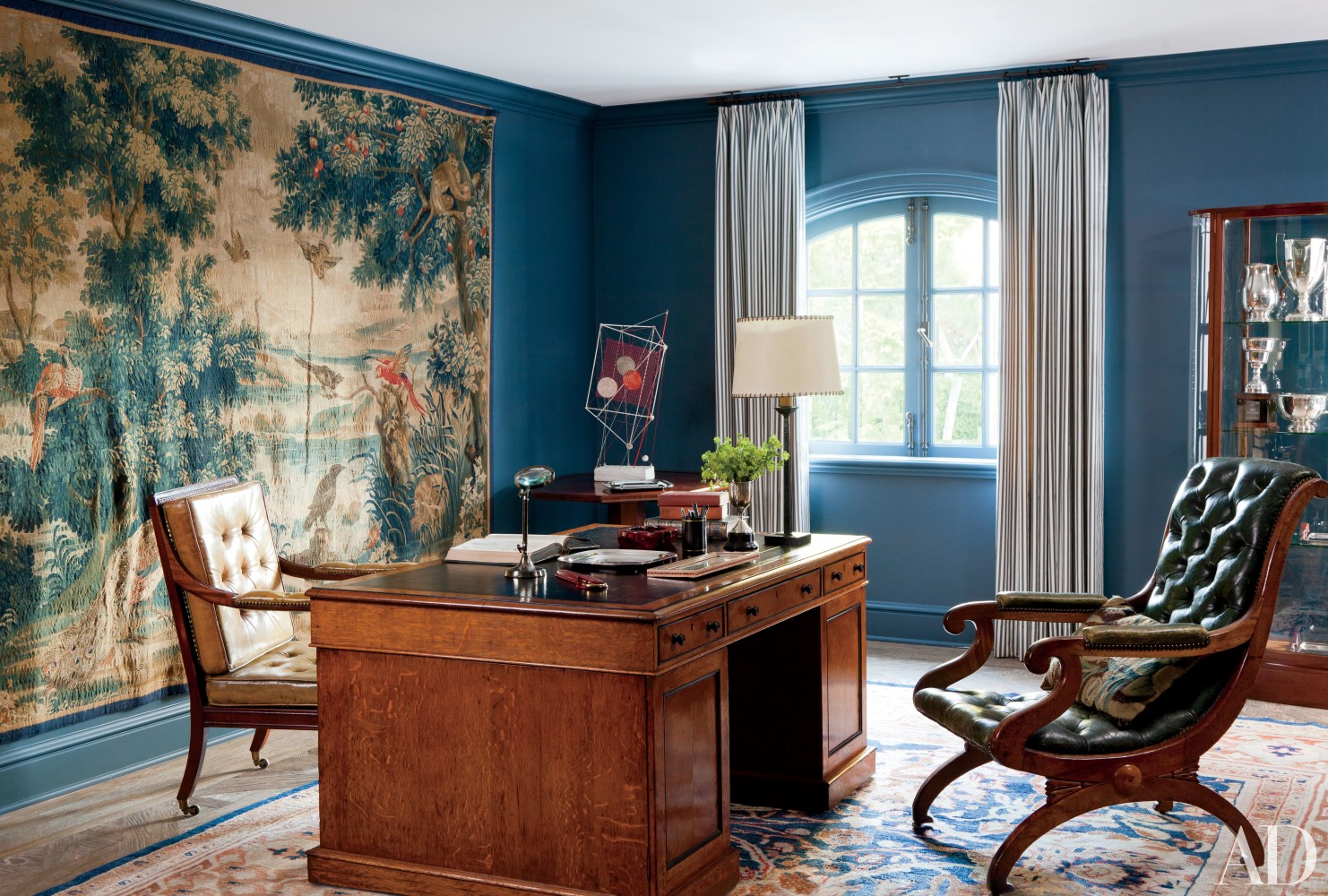 In a Beverly Hills home by Waldo Fernandez, the office features a 17th-century Belgian tapestry from Mansour, an English mahogany desk and, in the corner, a Wolfgang Roth sculpture from JF Chen.